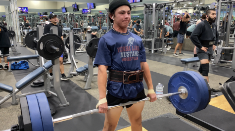 Eighth grader Cole Nerio uses power lifting to get into better physical and mental health.
